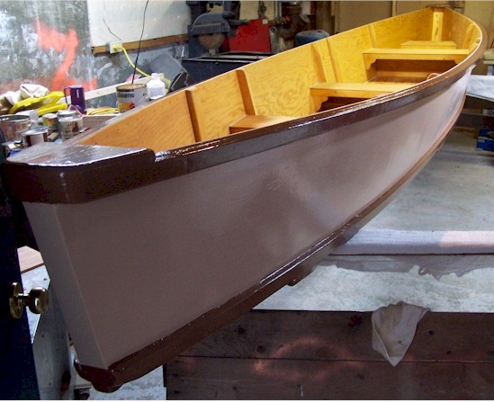 Canoe finished and painted, waiting to be carried out of the basement.